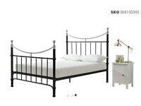 King bed frame, cast iron, wooden slats below mattress