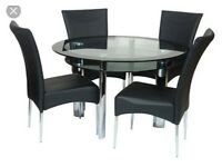 Harvey's black Glass Two Tiered table with leather chairs