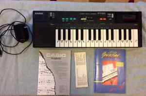 Casio PT180 Keyboard with Songbooks & Manual