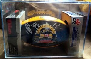 Autographed Hamilton Tigercats football in a hard plastic case
