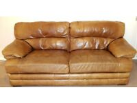 Tan leather Sofas and pouffee