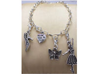 Silver plated charm bracelet with Tibetan silver charms