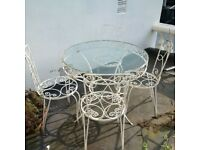 beautifully weathered garden table and four chairs can deliver