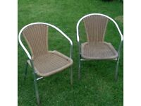 two good quality garden or patio rattan chairs