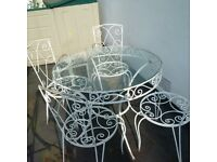 beautifully weathered large metal patio table and four chairs can deliver