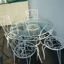 beautifully weathered large metal garden or patio table with four chairs can deliver