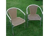 two rattan garden or patio chairs