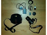 Canon 100D with 18-55mm Lens + 2x 16GB SD Cards, 1 Extra Battery, Carry Case + Remote