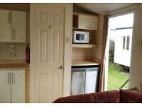 static caravan for sale at only 16,995 inc fees and insurance on Devon bay holiday park TQ4 7JP