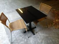 small bespoke black granite garden or patio table with two rattan chairs can deliver