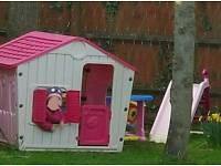 Girls garden playhouse and slide