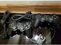 Two Black PS2 Dualshock Controllers And Memory Card Playstation