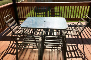 Patio dining set - beveled glass dining table with 6 chairs $90