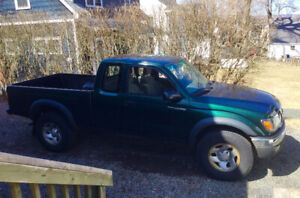 2003 Toyota Tacoma 4X4.  Minor dent on left side. $5,800