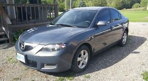 2009 Mazda 3. With new winter tires