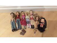Bundle of 8 Bratz dolls of various sizes plus clothes