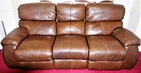 Large reclining 3 seater sofa and matching 2 seater sofa. Genuine brown leather