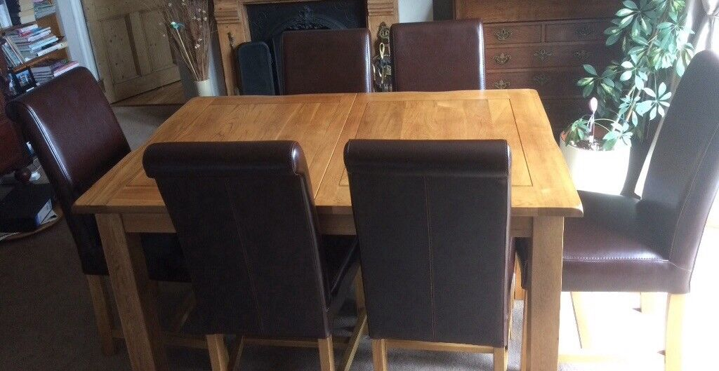 12 Months Old Barely Used Oak Dining Table And 6 Leather Chairs