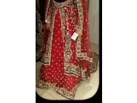 Beautifull red traditional wedding dress with long trail and in very good condition.