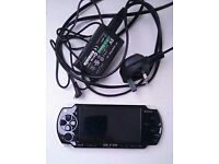 PSP black Slim and Lite with charger comes with 20 games