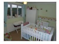 Used but good condition white cot bed, wardrobe and chest of drawers with baby changing facility