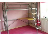 Metal framed high bed with under desk