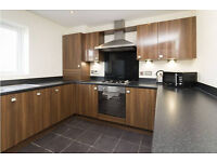 Modern-Used-Kitchen-with-CDA-Appliances-and-Peninsular-5-years-old. 5 years old