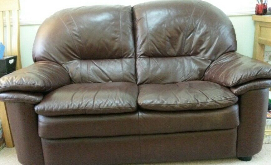 Leather 2 seater sofa, 1 chair and footstool