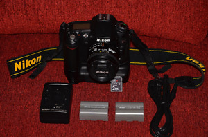 Nikon d90 with grip and 50mm/1.8 Nikkor lens + two batteries