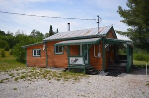 Splendid 4-season cottage with a big shed. Great DEAL!