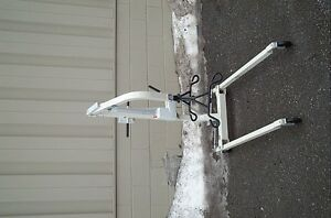 auto lift with slings  has hook up to charge it 1250.00