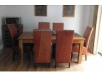 8x high backed leather chairs and solid acacia dining table