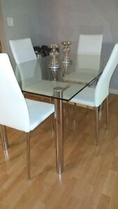 Glass dinning table with 4  white leather chairs