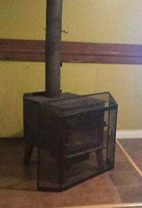 Wood stove with front grate