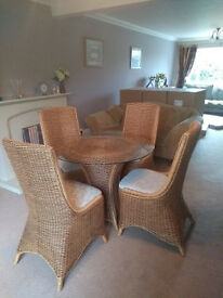 Circular Glass Top Conservatory Table and 4 Cane Chairs