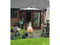 FOR SALE ROSEWOOD UPVC CONSERVATORY WITH WHITE INTERIOR.
