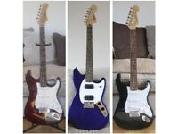3 Electric Guitars, All Low Action And All Play Really Well.