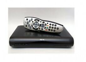 sky tv hd box with controller and cables