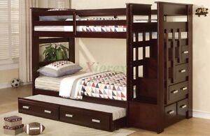 Dark wood bunkbed with trundle and dresser in stair case