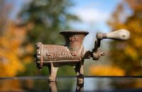 Antique metal meat grinder