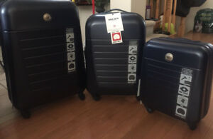 Brand new 3 piece Delsey hard luggage