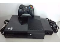xbox 360 slim + 4 games latest model
