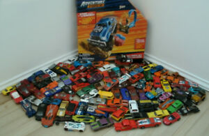 Large group of hot wheels and track