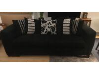 Large 3-4 seat black pillow back settee, sofa