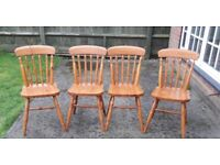 A set of 4 farmhouse style pine dining / kitchen chairs