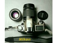 Nikon F 65 and two lenses.
