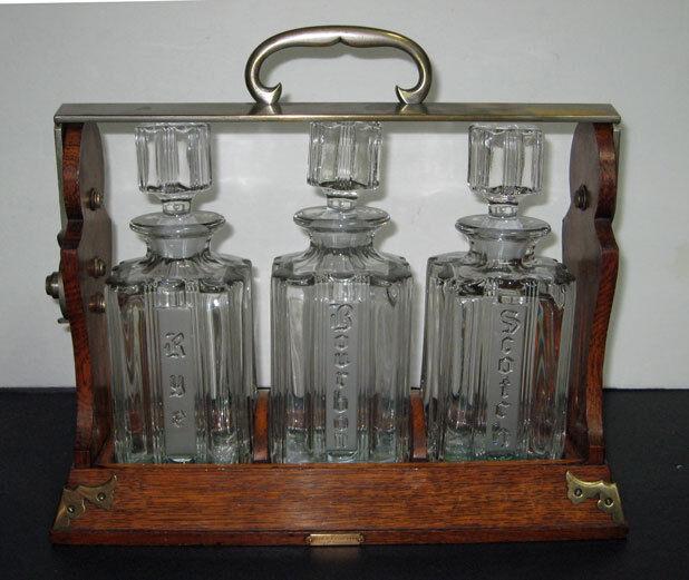antique English OAK TANTALUS ,LIQUOR CABINET  w/ 3 DECANTERS