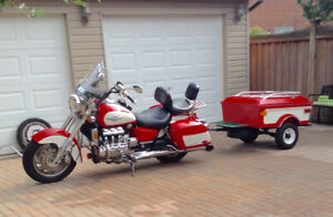 Bike,trailer, and spare parts for sale