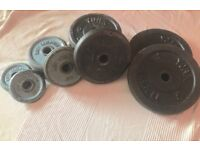 16x cast iron weight plates 61kg total and 2x barbell bars