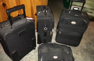 3 American Tourister black wheeled Suitcases
